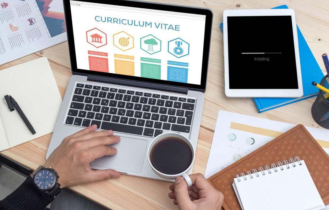Preparing a CV on a laptop